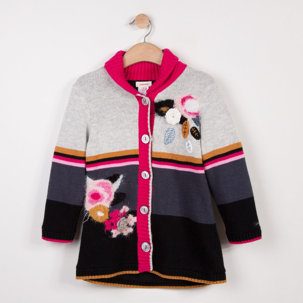 Jacket in soft and fluffy knit, with multicolored jacquard patterns. Soft, warm and padded fleece lining and two patch pockets. Catimini signature colors.
