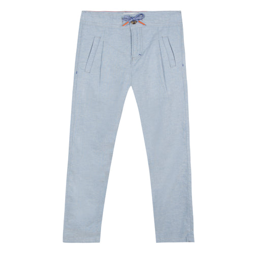 blue chambray pants have a graphic drawstring with orange ends. Fluid and light, silhouette is trimmed with two welt pockets at the front and back. Deigned by Jean Bourget.