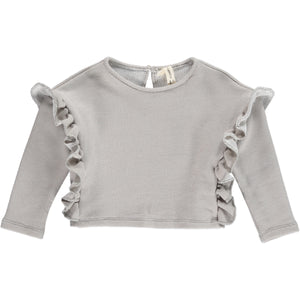 100% cotton top in grey outlined with ruffles down both sides. Designed by Vignette.