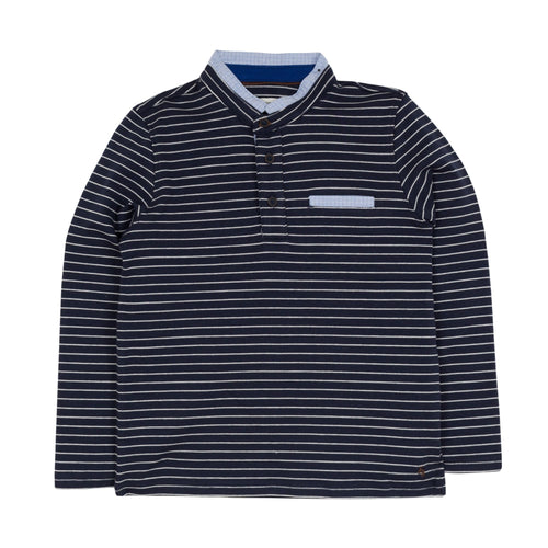 Jean Bourget navy blue long-sleeved polo shirt is punctuated with a sailor stripe. This classic look is twisted by a piped collar of light blue check fabric, matching the fake breast pocket and buttonhole.
