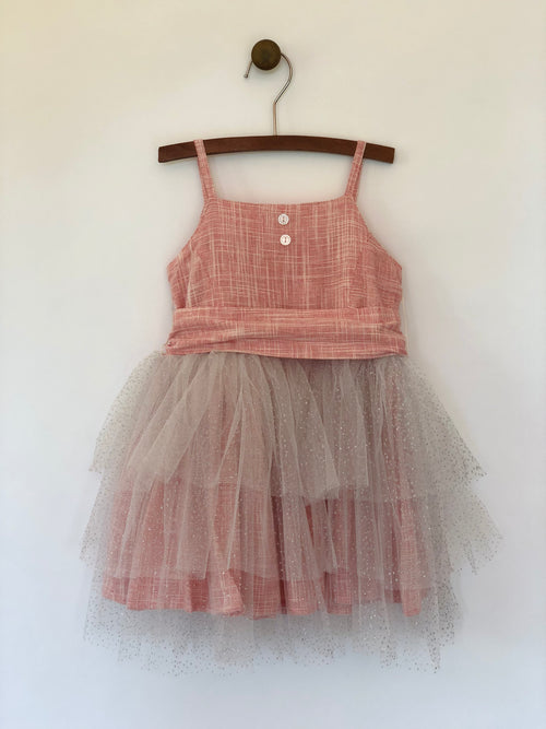 Girls rouge color tulle dress with large wrap around bow and straps. This dress is by Vignette.