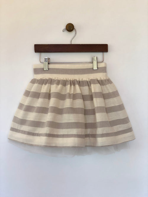 Girls grey and off-white skirt with wide stripes and tulle lining. Shop Vignette for girls.