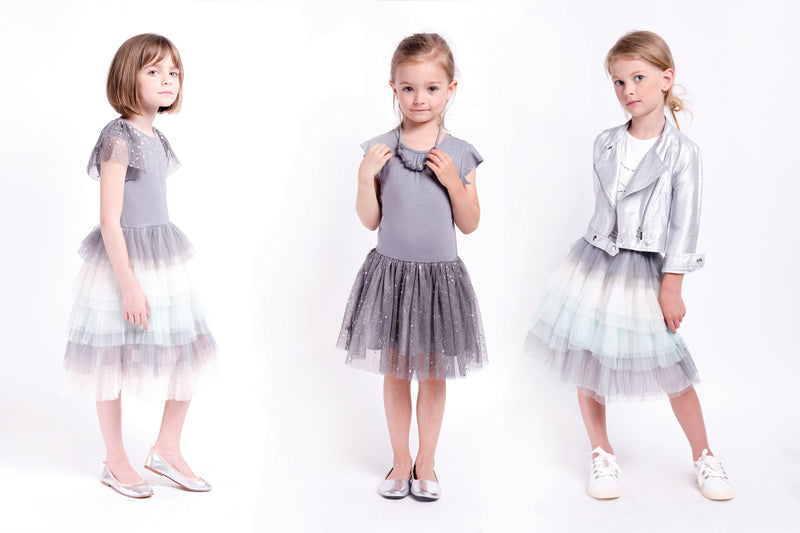 Ballerina tulle dress for girls with rhinestones decreeing the neckline and multilayered skirt with shoes of blues and grey. Image is the designer.