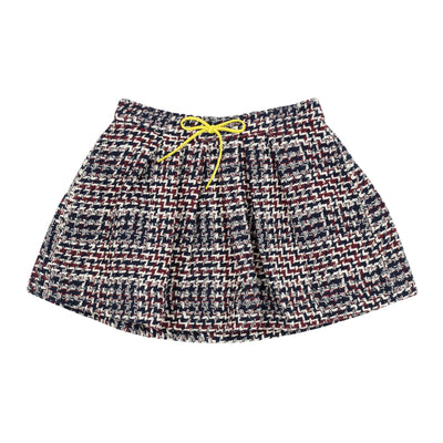 Jean Bourget retro-inspired pleated skirt features a thick navy, plum and ivory check weave. Graphic and trendy, this must have of the season is adorned with a contrasting bow at the neon yellow cord belt.