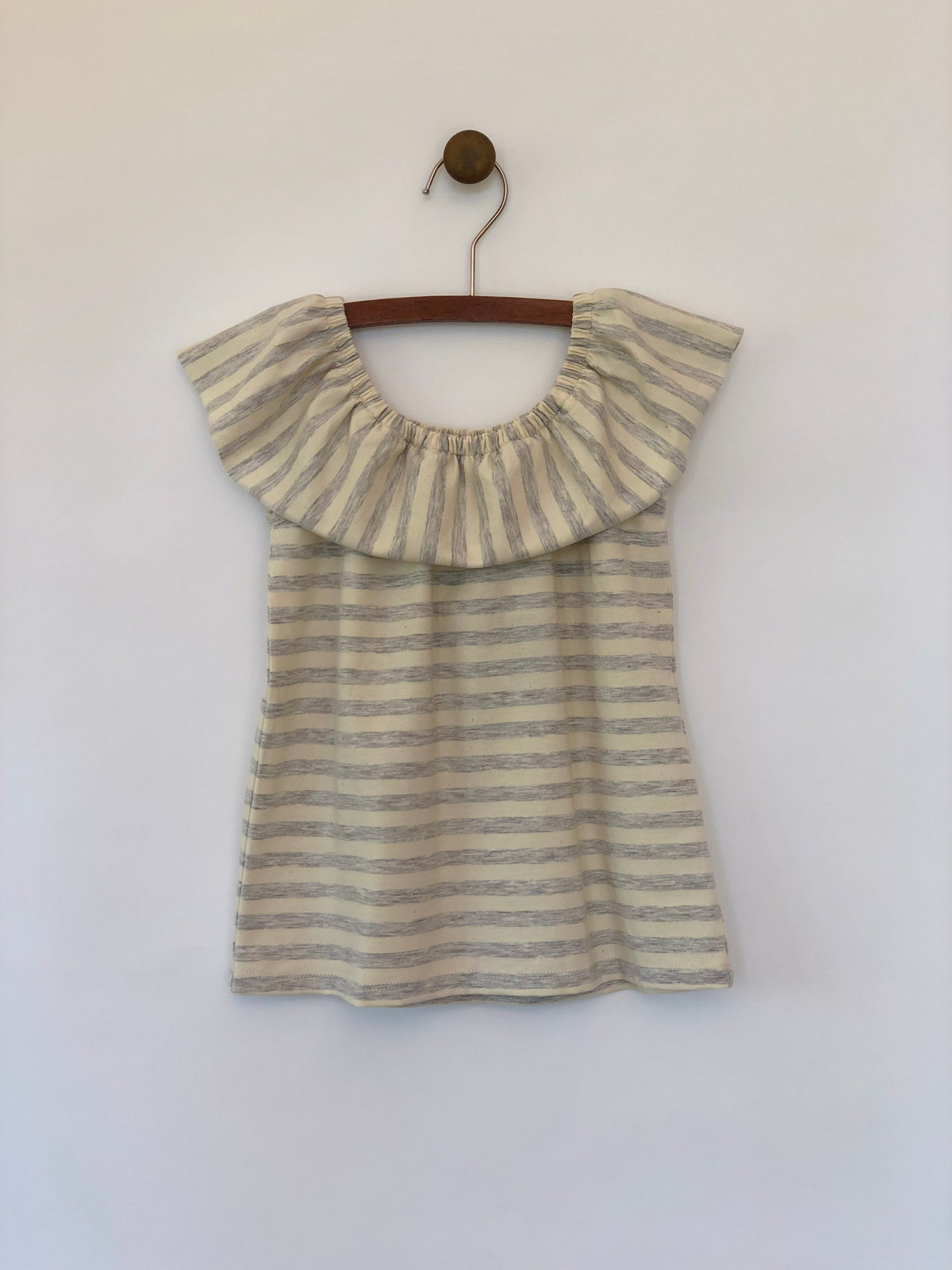 Girls sleeveless top in grey and ivory stripes with round draped collar by Vignette.
