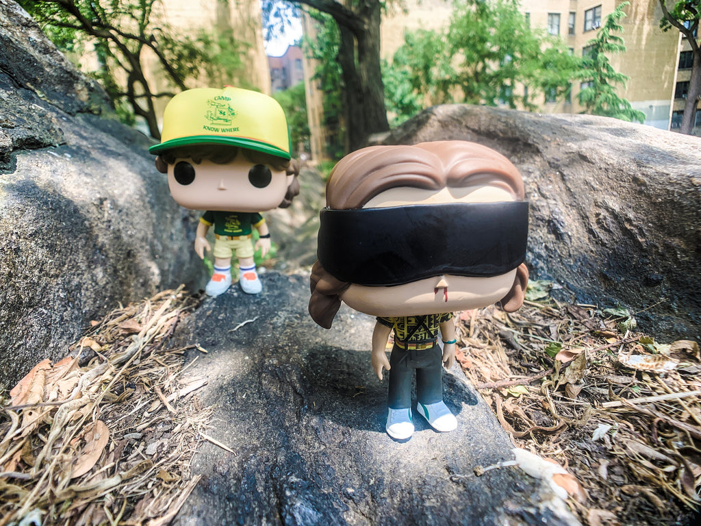 (Dustin Funko Pop, left, BAttle Ready Funko Pop, right