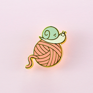 Josh the Snail with Yarn Ball Enamel Pin, gold color plated pink yarn