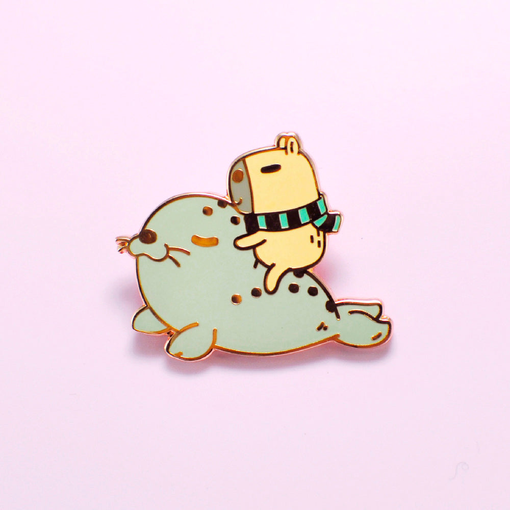 capybara and seal lapel pin by Noristudio