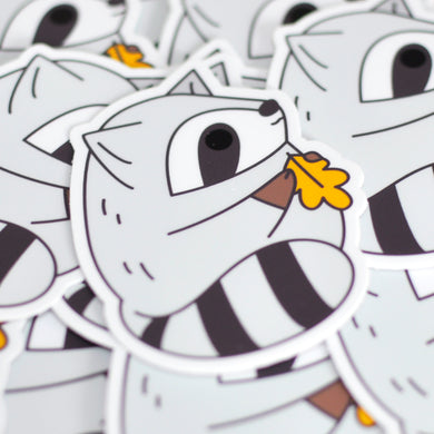 cute raccoon vinyl sticker by Noristudio