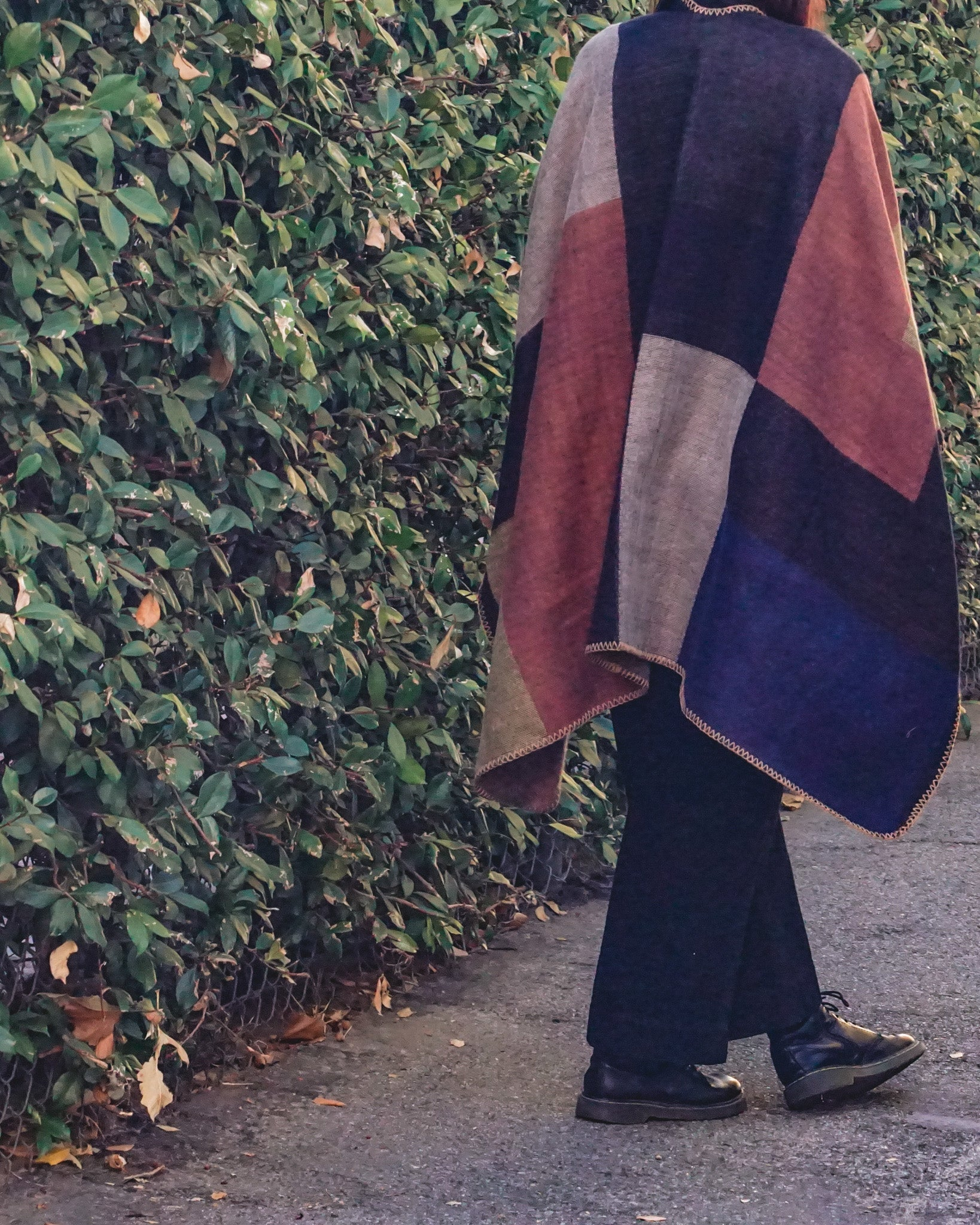 color-block poncho.