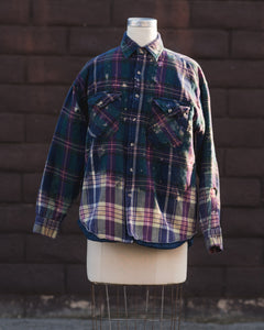 blue flannel jacket.