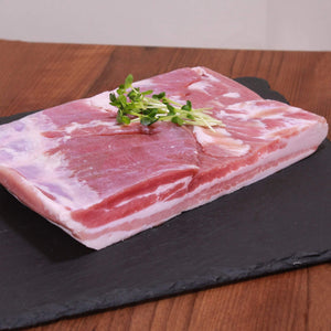 A big block of juicy pork belly from France. Best cut in thin slices and roasted in a frying pan or on a charcoal grill. You can even cure it and make your own bacon if you want to.