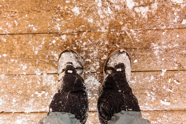 how to prepare your floors for winter: winter boots and snow