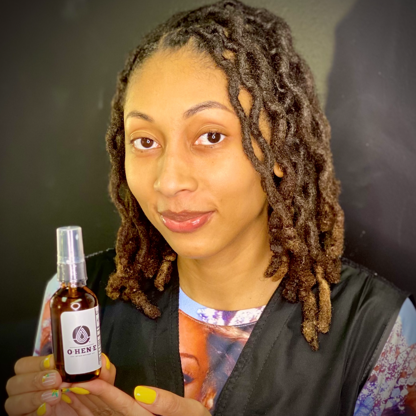 Maya Marchelle poses with OHENE Loc Libation Hair moisturizing oil