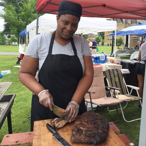 Lorraine from Smokey Divas cooking BBQ at Downtown Pittsfield Farmers Market