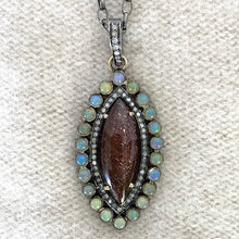 AFRICAN SUNSTONE PENDANT WITH ETHIOPIAN OPALS AND DIAMONDS