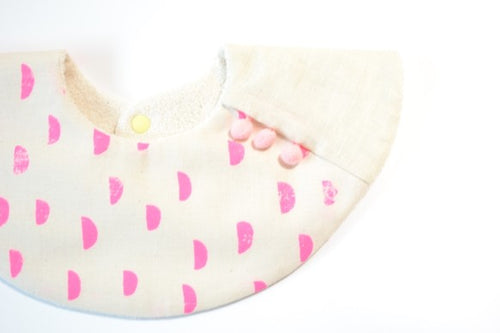 Bib Pompom Collar Bib in Pink Half Moon on Ivory - Happy Poppets