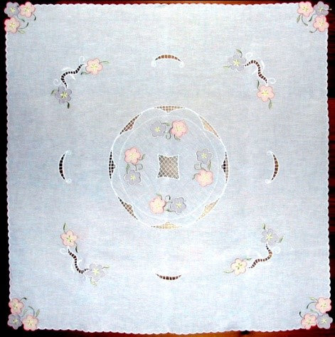 This beautiful table cloth is a a combination of cutwork, applique and lace with a decorative stitched edge.