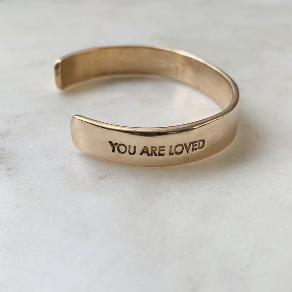 Handmade Bronze Cuff Bracelet with the words You Are Loved inscribed on it