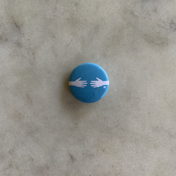 Blue and White Hug Button with Hands Reaching Toward Each Other