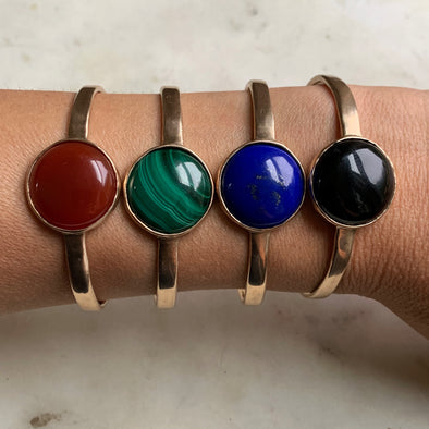Woman's Wrist with 4 Handmade Bronze Greta Cuff Bracelets with Different Color Stones