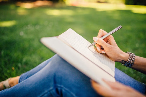 Person journaling in a park