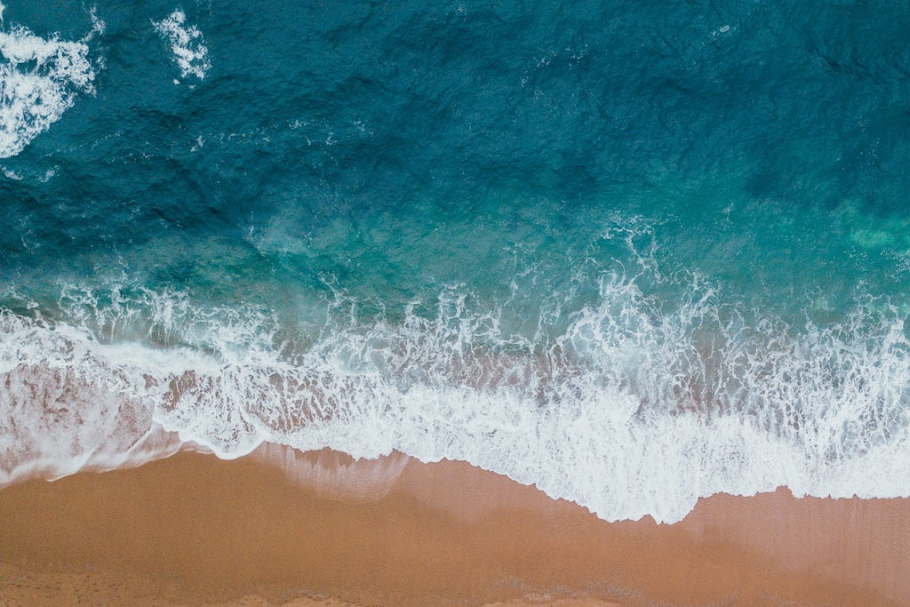 The colours of the ocean lapping the sand at Tamarama Beach, Sydney
