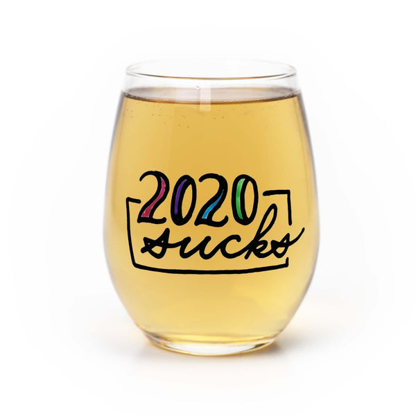 Stemless wine glass with white wine that says 2020 sucks in colorful hand lettering