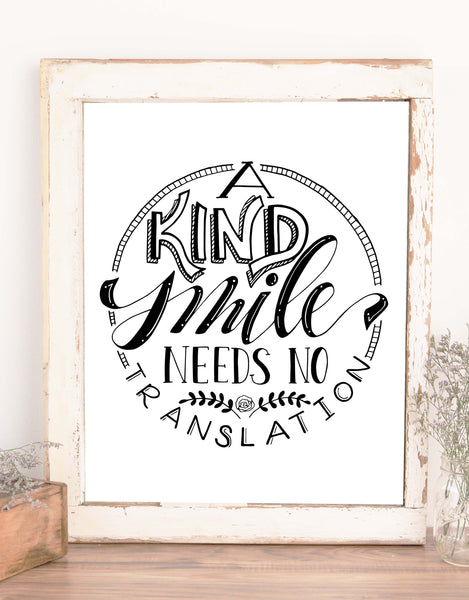 wall art typography design that says A Kind Smile Needs No Translation in black and white
