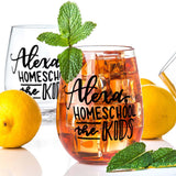 stemless wine glass with iced tea that says Alexa home school the kids in black hand lettering with lemons and mint