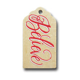 hand painted wooden gift tag that says believe in red and white.