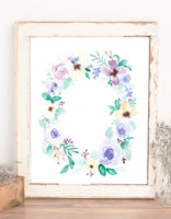 wall art of floral wreath with blue purple cream flowers and light and dark green leaves
