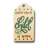 hand painted wooden gift tag that says unto you a child is born in green and gold