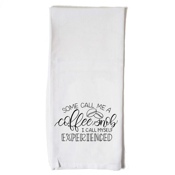 Hand lettered floursack kitchen towel in white that says some call me a coffee snob, I call myself experienced in black