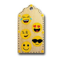 hand painted wooden gift tag with 5 different happy emojis