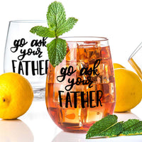 stemless wine glass filled with iced tea that says go ask your father in black hand lettering with lemons and mint