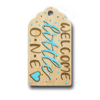 hand painted wooden gift tag that says welcome little one in mint and gold