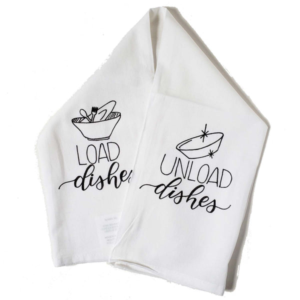 Hand lettered floursack kitchen towel in white that says load dishes with dirty dishes illustrated on one side and unload dishes with illustrations of clean dishes on the opposite side all in black