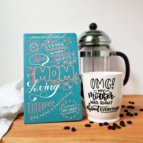 Mother's Day gift set including a hand painted mother's day journal and a hand painted mug that says OMG my mother was right about everything shown with scattered coffee beans and a french press and tea towel in the background