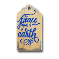 hand painted wooden gift tag that says peace on earth in blue and silver