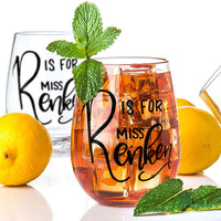 personalized stemless wine glass filled with iced tea that says R is for Miss Renken in black hand lettering with lemons and mint