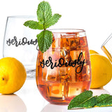 stemless wine glass filled with iced tea that says seriously. in black hand lettering with lemons and mint