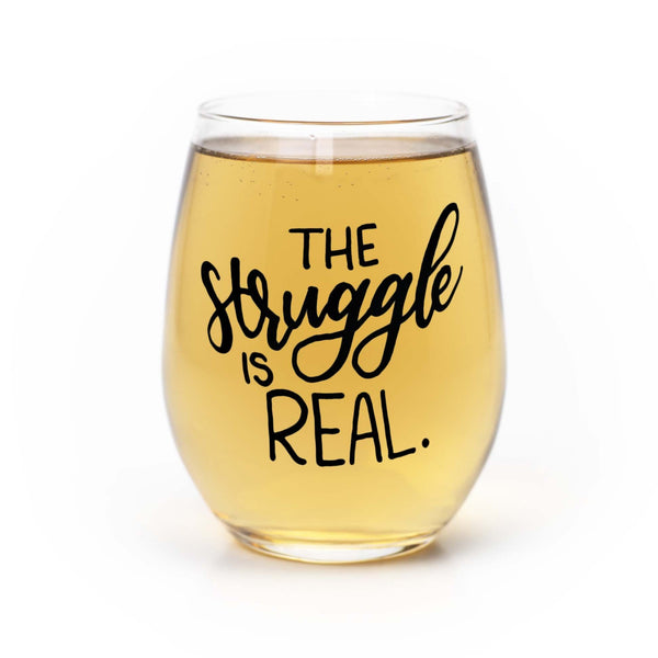 stemless wine glass filled with white wine that says the struggle is real in black hand lettering