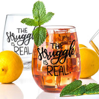 stemless wine glass filled with iced tea that says the struggle is real in black hand lettering with lemons and mint