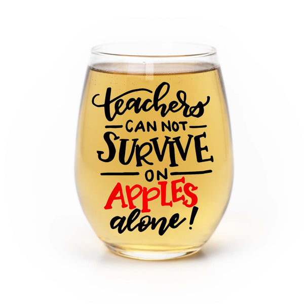 stemless wine glass filled with white wine that says teachers can not survive on apples alone in red and black hand lettering