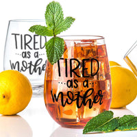 stemless wine glass filled with iced tea that says tired as a mother in black hand lettering with lemons and mint
