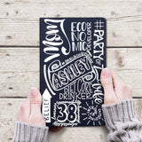 hand painted journal with lots of personalized words and phrases to make a word collage in white lettering of all different styles on a navy journal