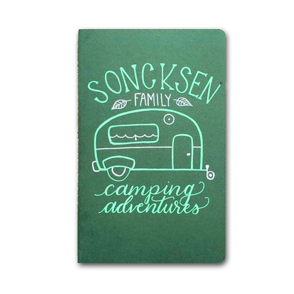 hand painted journal that says family camping adventures with an illustration of a camper in lime green and white