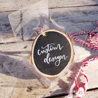 rustic wood slice ornament can be customized with any design in a clear gift box with red and white string