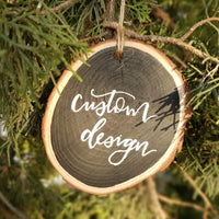 rustic wood slice ornament can be customized with any design hanging on a tree